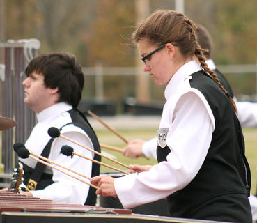"Kayti Dunn plays the marimba in ""the pit"" for the Marching Knights."