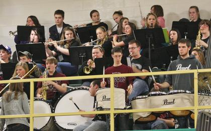 The Marion County High School band plays during a break in action during the first round game of the 5th Region Tournament against Washington County.