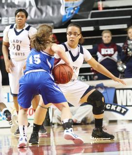 Junior Makayla Epps applies defensive pressure to a Walton-Verona player.