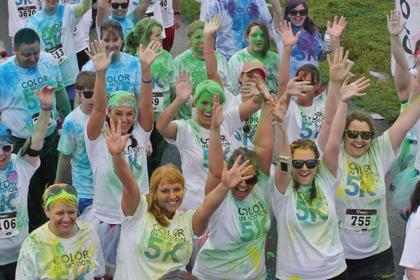 A group of runners show their excitement before they started the Color in Motion 5K Saturday morning.