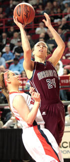 Bre Elder drives to the basket against Butler.