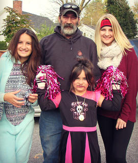 Norman Mitchell and his daughters - Nora, Natalie and Marisha – enjoy trick-or-treating together last week.