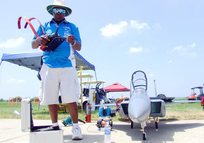 Event organizer Lewis &quot;The General&quot; Patton prepares his plane for a solo flight during the opening ceremonies for the 2011 Jets Over Kentucky model jet show.
