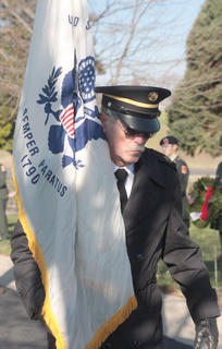 Donald Webb of the Marion County Veterans Honor guard carries a flag in honor of the Coast Guard during Saturday's ceremony.