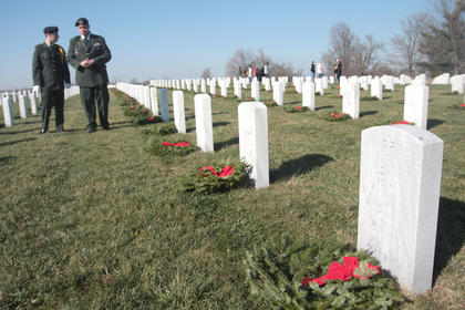 Marion County JROTC members, Dylan Bright and Jabari Scott, chat after helping place wreaths throughout the Lebanon National Cemetery.
