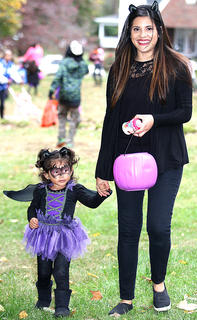 Trick-or-treaters flocked to Spalding Avenue in Lebanon for trick-or-treating Saturday evening. Pictured is Diana Almendra and her two-year-old daughter, Camila, enjoy trick-or-treating on Spalding Avenue Saturday evening.