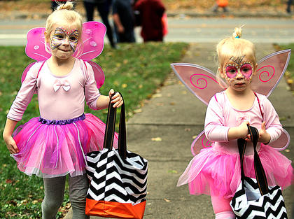 Sisters Hadley Potter, 4, and Reagan Potter, 3, dressed as sparkly princess fairies for Halloween.