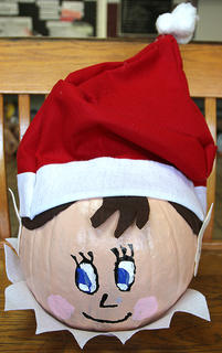 This pumpkin looks just like an Elf on the Shelf. The Elf on the Shelf: A Christmas Tradition is a cleverly rhymed children's book explaining the story of Santa's scout elves, who are sent to be Santa's eyes and ears at children's homes around the world.