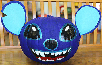 "This pumpkin was created to look like Stitch, a character from the Disney animated movie ""Lilo & Stitch."""
