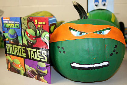 "This pumpkin was inspired by Michelangelo, the youngest Teenage Mutant Ninja Turtle, and the book, ""Epic Turtle Tales."""