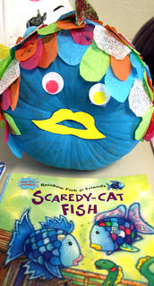 "This pumpkin was inspired by the book ""Scaredy-Cat Fish,"" which is about a fish named Spike who decides it's time to face his own fears head on. But that means venturing into the deep, where young fish are forbidden to go. Luckily, Jonah the whale is there to protect Rainbow Fish and teach him a valuable lesson about common sense."