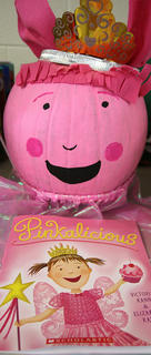 This pumpkin is pink, pink, pink! Pinkalicious is a children's book about a little girl who loves pink, especially pink cupcakes. Her parents warn her not to eat too many of them, but when Pinkalicious does . . . she turns pink!