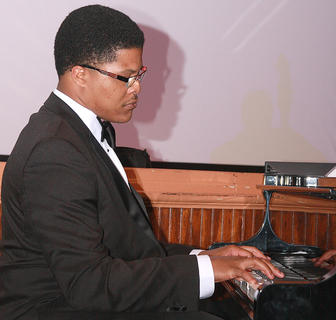 Kendall Carter tickles the ivories during the performance of some hits of the 1950s.