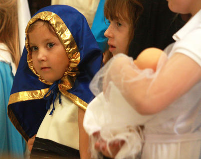 Katie Zink, as Our Lady of Gaudalupe, looks out at the crowd during the All Saints Day Mass.
