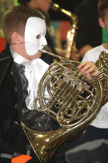 Brandon Miles, as the Phantom of the Opera, also plays the French horn.