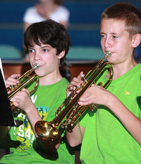 Cody Abell (left) and Jaxon Wheatley play the trumpets.