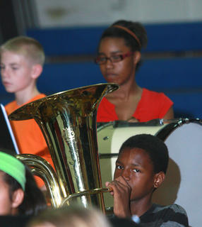 David Dupree (front) plays the tuba, while percussionists Austin Patton and Eternity Smith perform in the background.