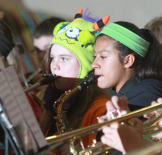 Alivea Peake (left) was dressed to frighten, but she and Andy O'Daniel both played the saxophone during the performance.