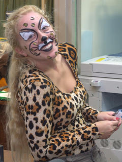 "Library aide Amelia Bradshaw is easy to ""spot"" in her cat costume."