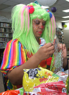 Circulation librarian Wanda Hazelwood gets serious about making goodie bags fun.