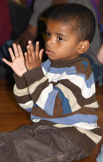 Jacob Smalley, a preschool student at Glasscock Elementary, claps along with the music.
