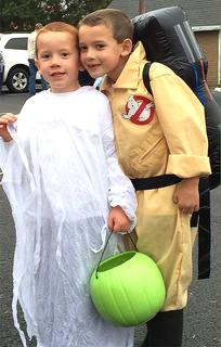Isaac Wright dressed as a Ghostbuster and Owen Wright dressed as a ghost for Halloween.