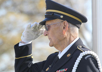 Jim Moore salutes the Marion County High School JROTC Color Guard as they retire the colors.