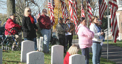 In a sea of color, people watch the ceremony unfold at Lebanon National Cemetery.