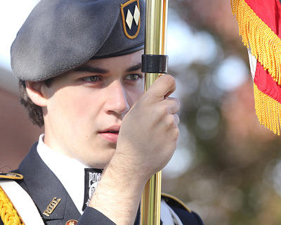 John Cox holds a flag with the Marion County High School JROTC Color Guard.