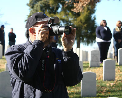 Joe Lamkin, a veteran, photographs the podium.
