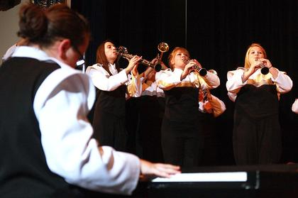 """The Marion County High School Marching Band performed this year's competition piece, """"Visionary,"""" during Saturday's concert. Playing the clarinets are Andrea Ackerman, Kristina Leake and Kaitlin Gribbins. Kelly Evans has her back to the camera."""