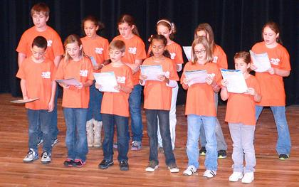 A chorus of students from West Marion Elementary opened the program by singing a few songs.