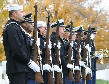 Hundreds of people attended the annual Veterans Day program Sunday at the Lebanon National Cemetery. Local officials paid tribute to the men and women who have served our country in the armed forces with prayers, music and a speech by retired military chaplain Rev. Benedict Brown. Pictured are members of the Marion County Veterans Honor Guard standing at attention before firing a three-round volley in honor of veterans who have died.
