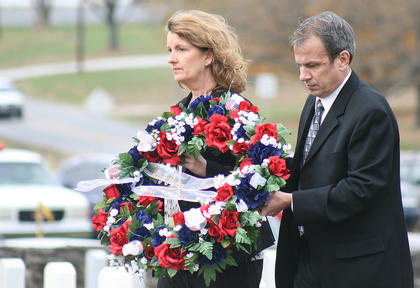 Kris Horseman, left, and Jim Ball place a wreath in honor of their fallen, Major Gen. James Donald Ball, the most recent local veteran to be interred at Lebanon National Cemetery.