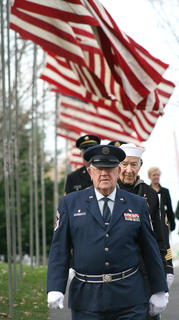 Paul Powell leads a procession of members of the Marion County Honor Guard at the start of Sunday's ceremony.