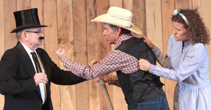 "Live theater returned to Lebanon with the performance of ""Lovely in Danger."" In this scene, Hoot Galoot (Andy Colley) stands between Amy Lovely (Stevie Lowery) and the villainous Filmore Filcher (Lynn Farris)."