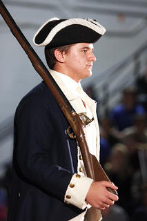 Hunter Winsor portrays a soldier during the Revolutionary War. The program included a brief history about all of the country&#039;s armed conflicts.