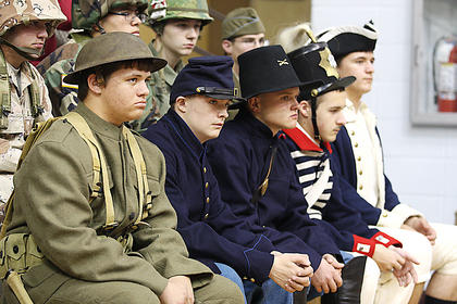 Pictured, from left, dressed in different military uniforms, are Alex Hyatt, Cory Lanham, Austin Mings, Dylan Bright, Hunter Winsor, Andrew Villanueva, Kristian Santiago and Vincent Pigati.