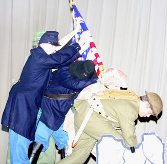 JROTC students emulate one of the most famous World War II incidents, the raising of the flag at Mount Suribachi on the island of Iwo Jima. Pictured, from left, are Trevor Schuck, Cory Lanham, Austin Mings, Andrew Villanueva and Alex Hyatt.