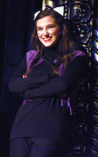 Alley cat Presley Wilson smiles as she enjoys the vocal talents of her brother, Bobby Wilson, who plays the part of Thomas O'Malley, the friendly alley cat who befriends the Aristocats and falls in love with Duchess.