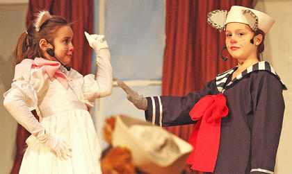 Abigail Adams, left, plays the part of Marie, the middle kitten, who is very bossy and believes that by being female, she is the best of the three kittens. Right, Chloe Allen, plays the part of Berlioz, the youngest kitten. He is somewhat timid and shy.