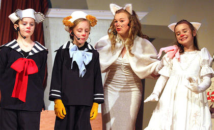 Pictured, from left, are Chloe Allen (as Berlioz), Gracie Wilson (as Toulouse), Jane Palagi (as Duchess, mother of the three kittens) and Abigail Adams (as Marie).