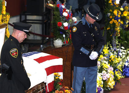 Honor guard members changed every 15 minutes to keep watch over Rakes' casket prior to his funeral Saturday at Marion County High School.