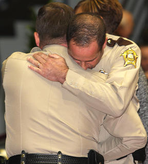 Sheriff Clements accepts condolences from one of the hundreds of law enforcement officers from around the state who paid their respects to Rakes.
