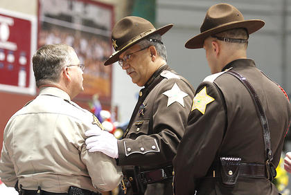 Mark Beatley and Deputy Brian McWilliams of the Marion County (Ind.) Sheriff's Department pay their respects to Sheriff Jimmy Clements.