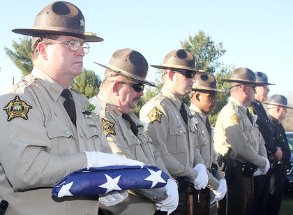 Members of the Marion County Sheriffs Department honor their fellow officer at the Old Liberty Cemetery.