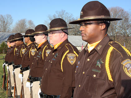 The Jefferson County Sheriff&#039;s Honor Guard stands at attention awaiting Rakes arrival at the Old Liberty Cemetery.