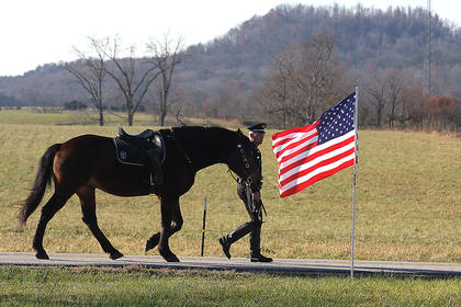 "Leading the hearse was a riderless horse. On the horse was a saddle, which was placed backwards, with boots reversed in the stirrups. The riderless horse stands among the highest honors for the fallen. Often referred to as the ""cap horse,"" the boots facing backward in the stirrups symbolize that the fallen won't ride again and the rider is looking back on his family one last time."