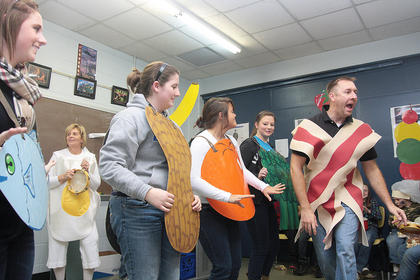 West Marion Elementary Principal Benjamin Mattingly (as bacon) performs a breakfast rap with backup from Alisha McDaniel (fish), Gayle Kelly (eggs), Alisha Elder (peanut), Emily Mattingly (orange) and Caroline Browning (broccoli). 