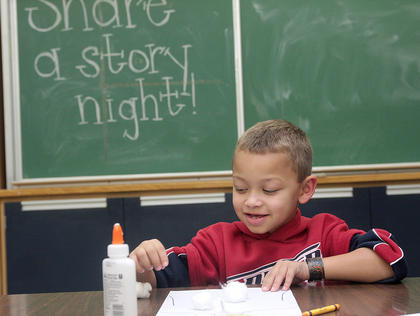 Marion County High School recently hosted its annual Share A Story Night on Nov. 15. In addition to promoting reading with the book &quot;Good Enough to Eat&quot;, the program encouraged students to made healthy decisions about food and exercise. Kaden Sallee works on a craft designed to help teach students about the digestive system.